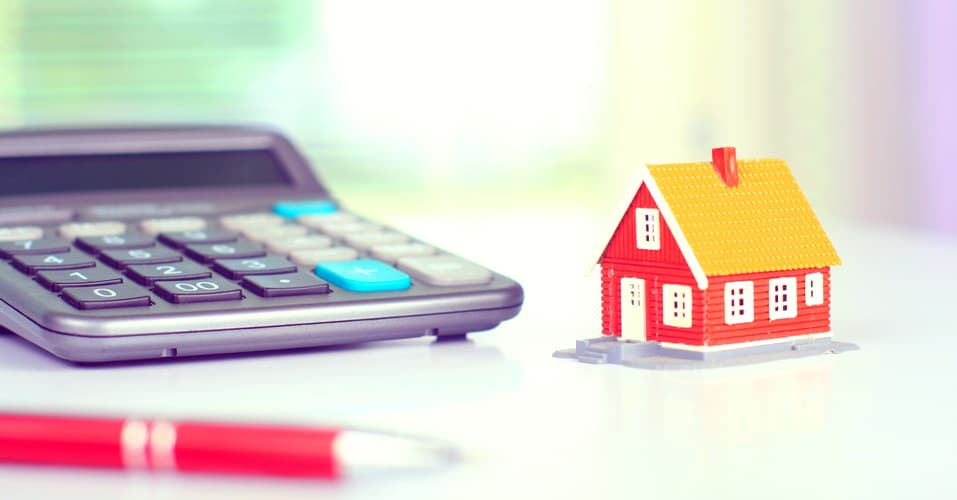 model house next to calculator