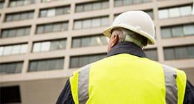 surveyor looking at building