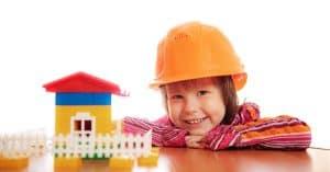 child building lego house