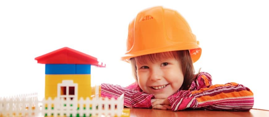 child building lego house