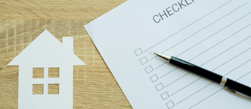 paper checklist next to house