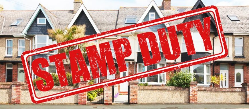 red stamp duty sign over row of houses