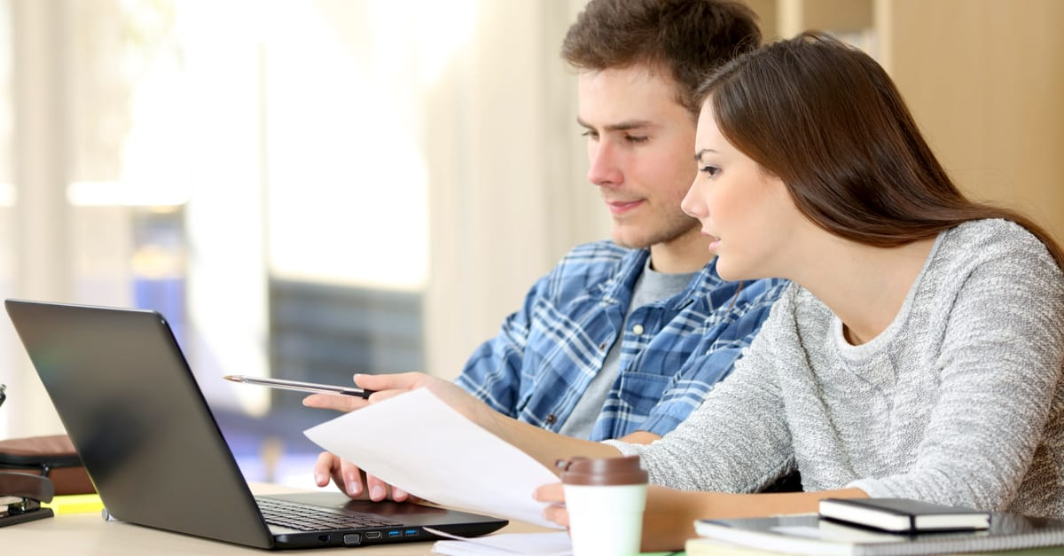 couple looking at quotes online