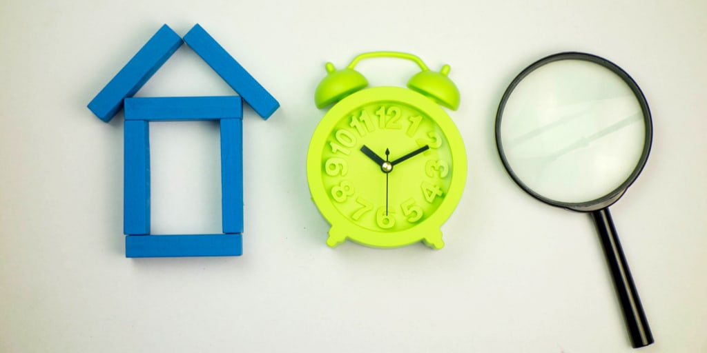 A house a clock and a magnifying glass