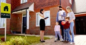 Family outside a property with estate agent