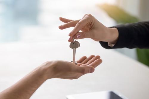 Conveya cing solicitor handing over keys to buyer